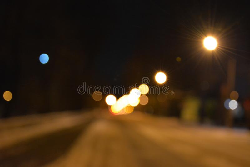 A look at the evening streets through watery eyes royalty free stock photo