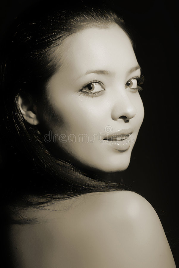 Look girl, close-up. Portrait of young nice girl in dark tonality, close up stock photos