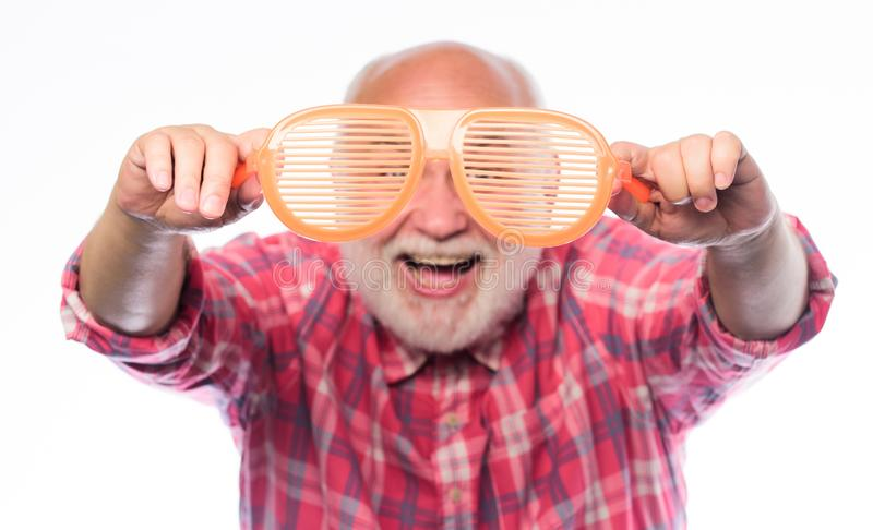 Look through glasses. mature bearded man isolated on white. hello summer. man hold party glasses. happy birthday. Corporate party. anniversary. holiday royalty free stock photo