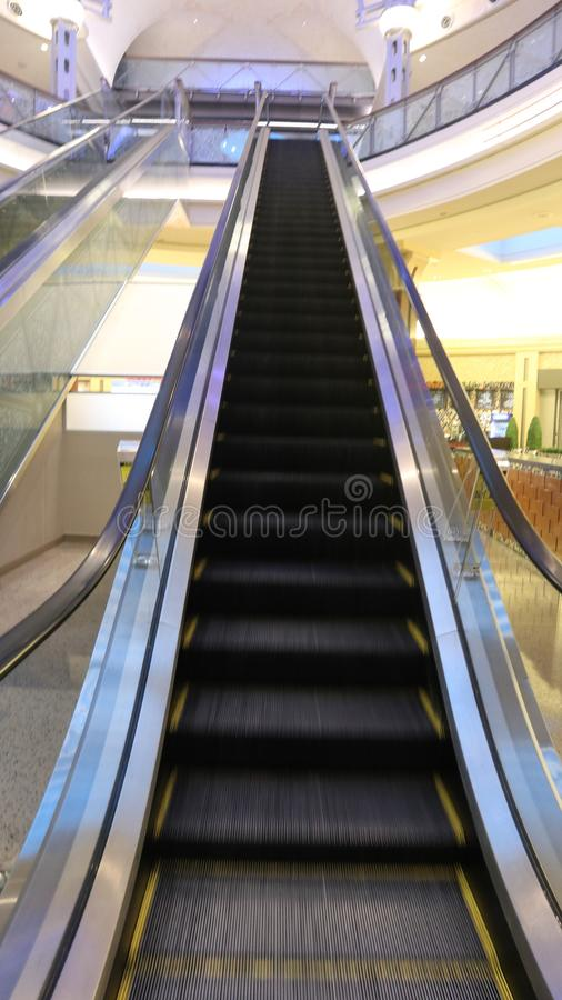 A look at a going up escalator stock photography