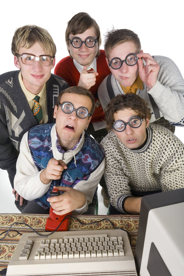 Look at him. Five nerdy guys sitting in front of old-fashioned computer. They are looking at camera. One of them is pointing at camera. Front view, white royalty free stock photos