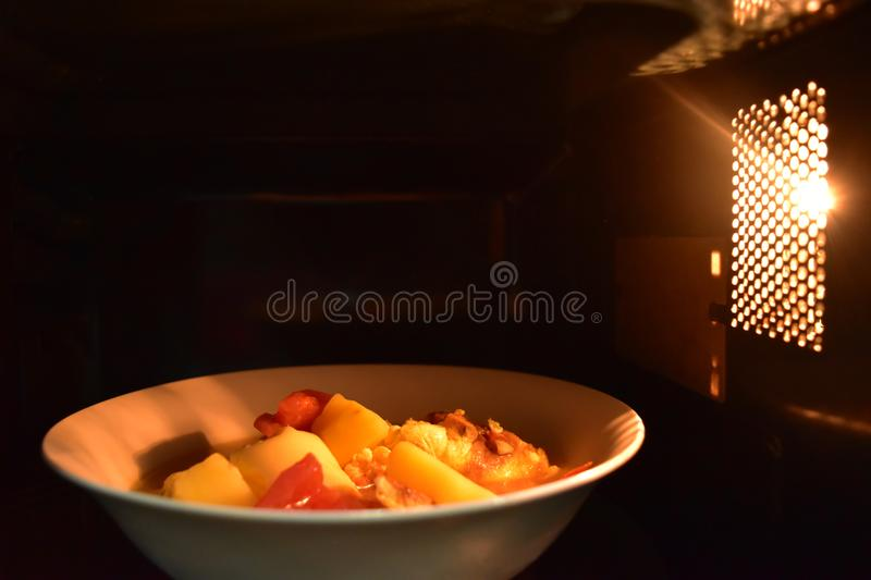 Look inside the microwave food white bowl, In a warm atmosphere and empty top space for text. Non color ceramic applicable to available with microwave stock images