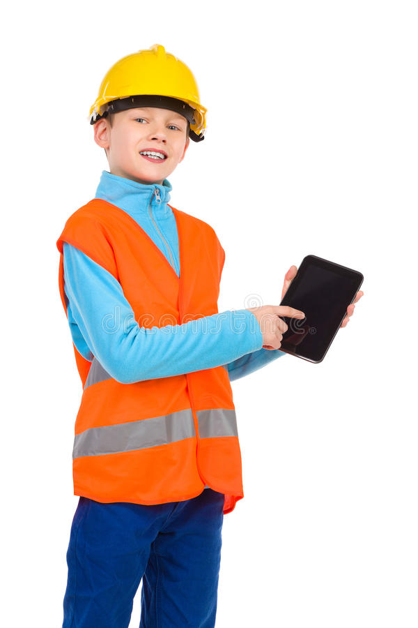 Look at my digital tablet. Young boy in yellow hard hat and orange reflective vest holding a digital tablet and pointing. Three quarter length studio shot royalty free stock photos