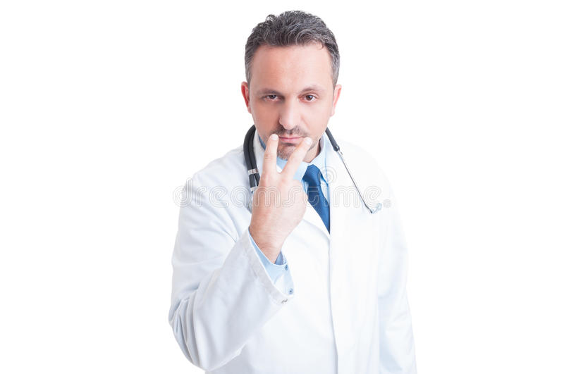 Look into my eyes pay attention gesture made by doctor royalty free stock photography