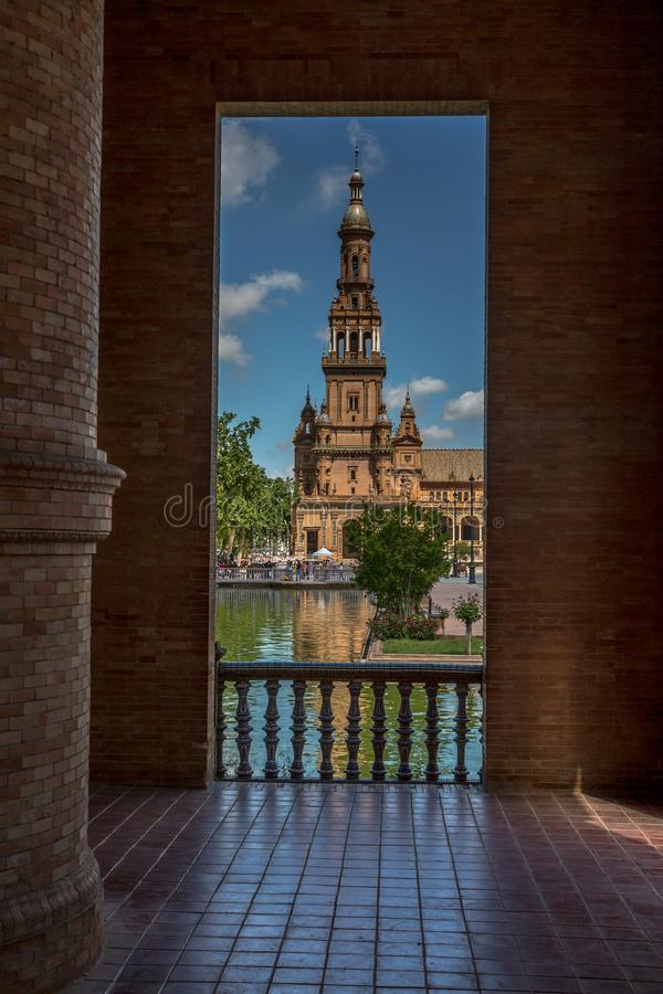 Through the archway at Plaza de Espana in Seville, Spain royalty free stock photo