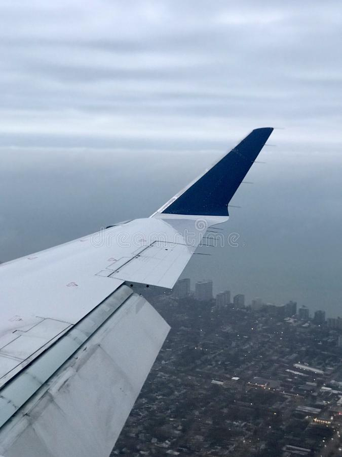 A look out onto Northeast Ohio under the wing of an airplane royalty free stock photo