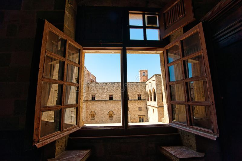 View from the window,Palace of the Grand Masters Palace Rhodes. We look out of the window into the internal courtyard of the palace. The Place of the Grand royalty free stock image