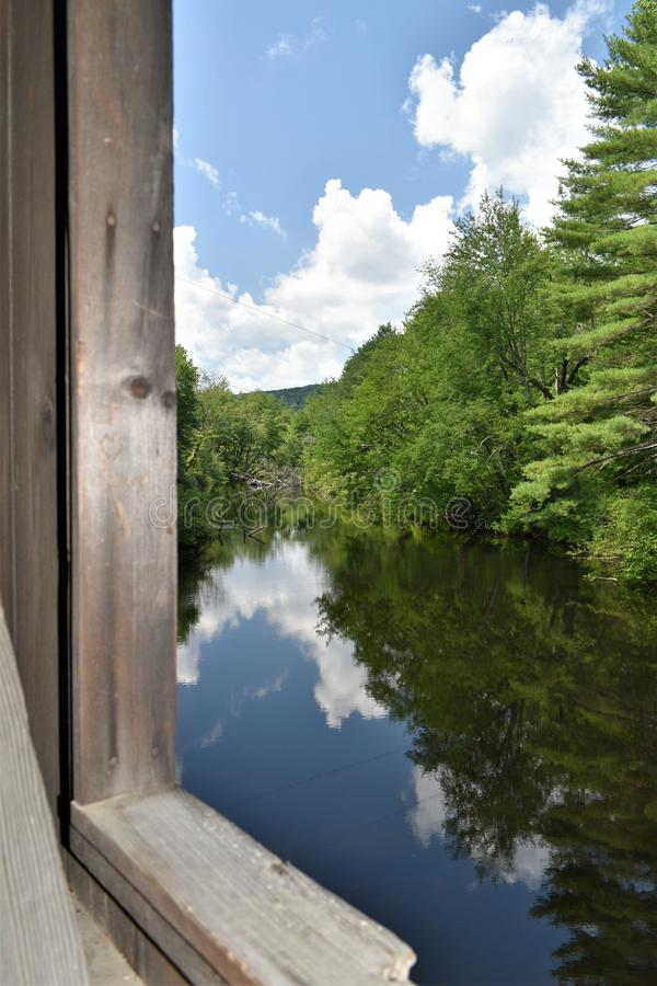 Waterloo Covered Bridge, Town of Warner, Merrimack county, New Hampshire, United States,  New England. A look out the window opening of the Waterloo Covered stock photos