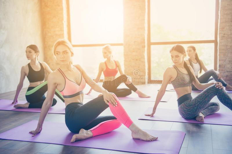 Look over the shoulder, sitting twisted. Flexibility exercise. F royalty free stock photo