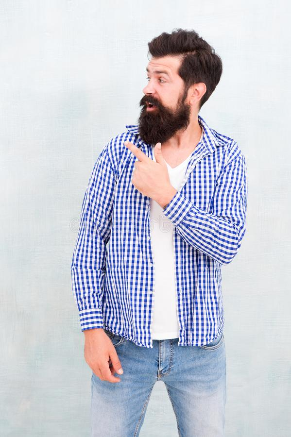 Look over there. Male casual fashion style. barber care for real men. brutal hipster with mustache. Mature hipster with royalty free stock image
