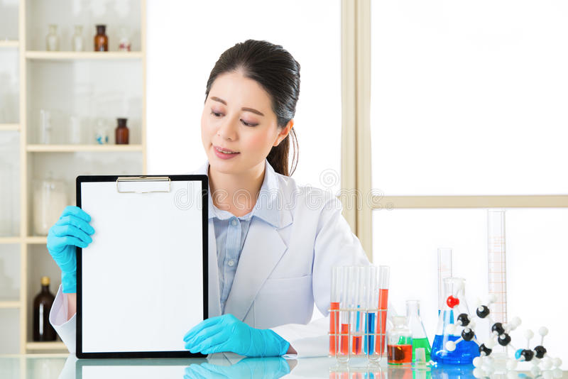 Look at science research result on clipboard and show stock photos
