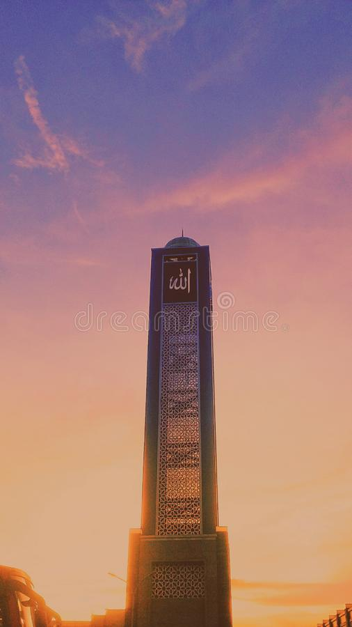 Look at the sky, beautiful like you. Golden, pastel, purple, peach, mosque, indonesia, cloud, clear stock photography