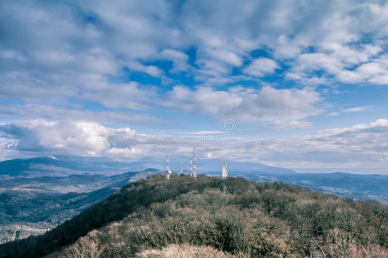 Look at the sky - look how the clouds float. The mountains are covered with clouds. Fascinating horizon. Nature you beautiful. View from mount Ahun. beautiful stock photography