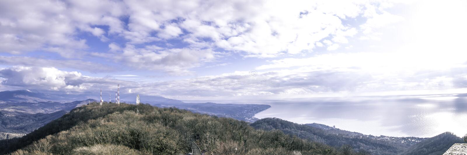 Look at the sky - look how the clouds float. The mountains are covered with clouds. Fascinating horizon. Nature you beautiful. View from mount Ahun. beautiful stock image