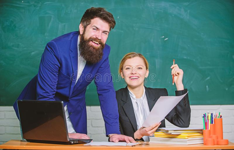 Look at this. teacher and student on exam. businessman and secretary. back to school. Non-formal education. paper work royalty free stock image