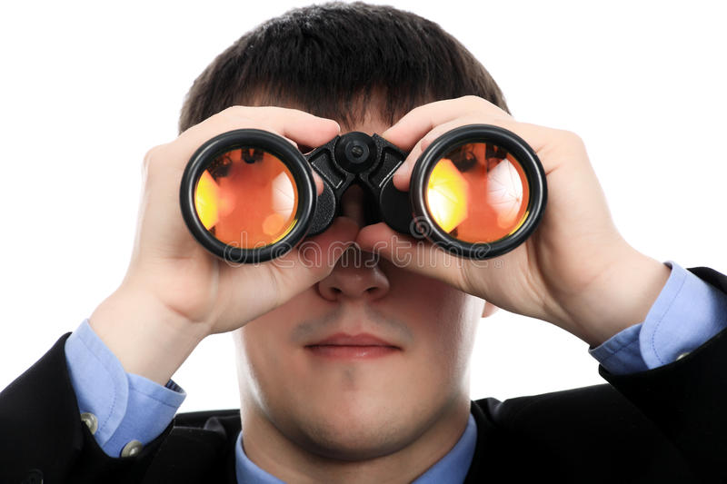 Look to the future. Portrait of a young man looking through a binocular. Theme: education career, success royalty free stock photos