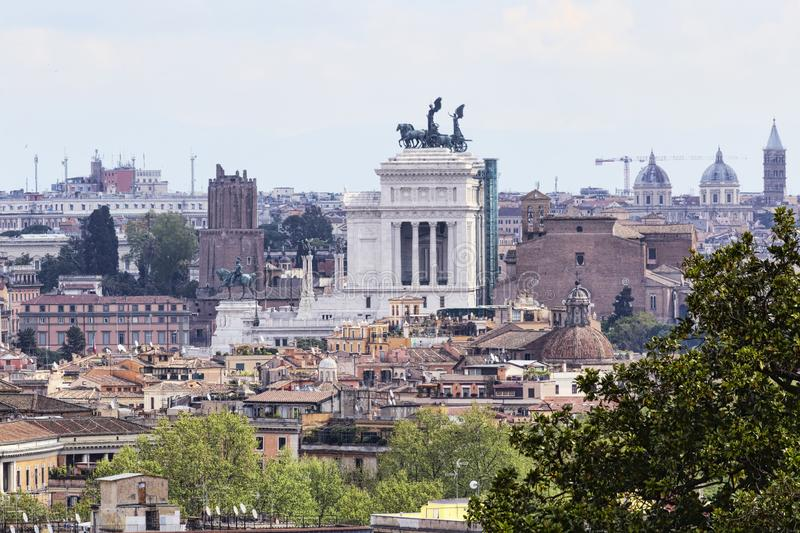 A look to Rome and its urban architectural beauties with the profile of the monumental altar of the homeland. Historic buildings and ancient houses and many royalty free stock photo
