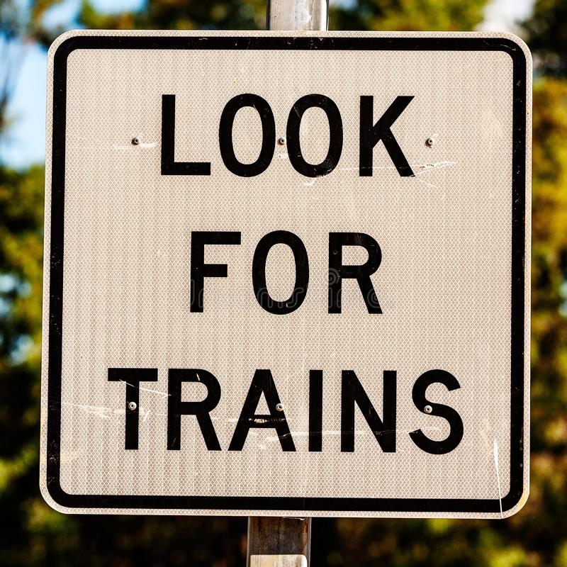 Look for trains - Australian signs found along the road. Black look for trains font on white reflective background in square format - Australian signs found royalty free stock photos