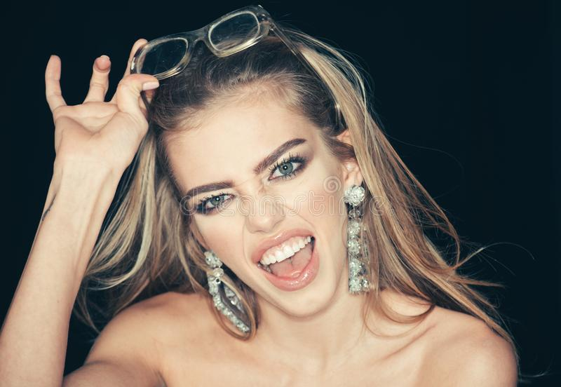 Always look trendy. Happy woman with glasses. Sensual woman smile with makeup and long hair. Hairdresser salon for stock photo