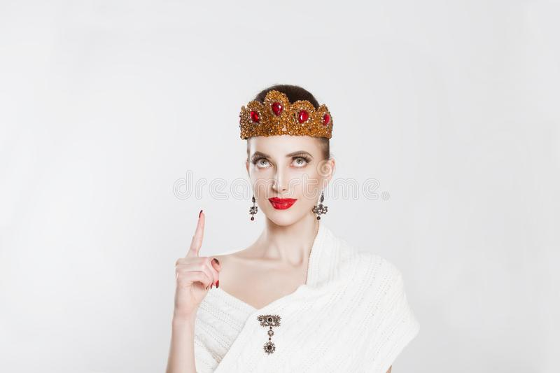 Look up here. Pretty cheerful woman gesturing with index finger and showing up one aha, i figured it out hand gesture royalty free stock image