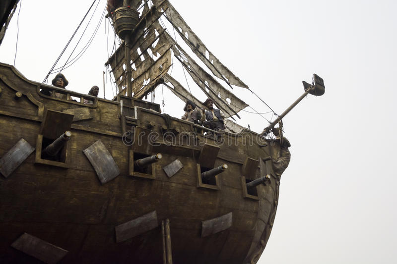 Look up the pirate ship and the pirate landscape. Pirate ships and pirates, scene model,details of the side of the ship stock photos
