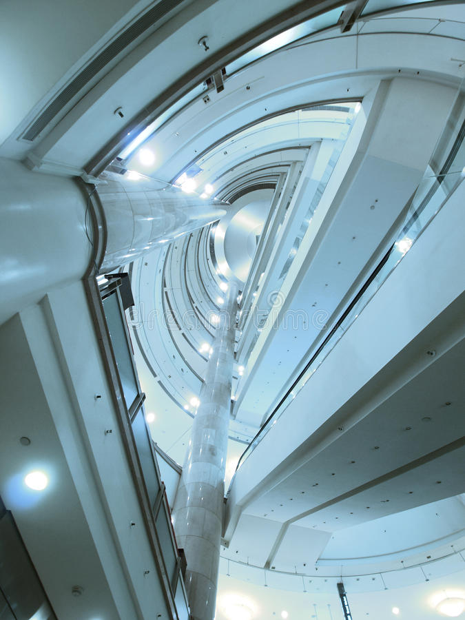 Look upward escalator. In modern building stock photos