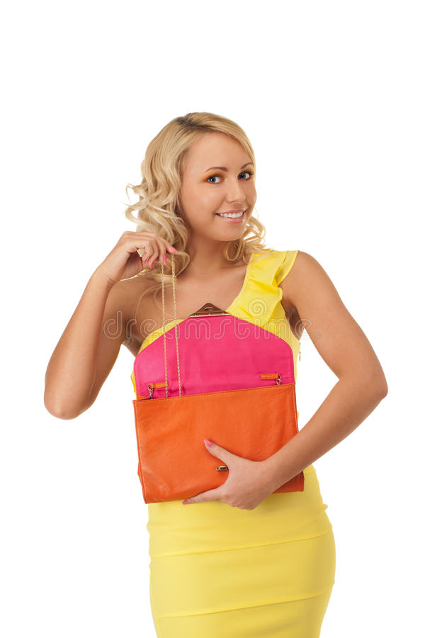 Look what luxury do I have. Young girl is taking chain out of handbag stock photography