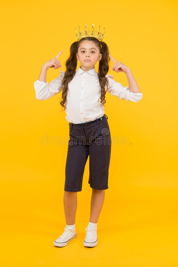 Look who is a big boss here. Little big boss on yellow background. Cute girl boss wearing crown. Small child with big. Ambitions. Adorable boss lady being stock images