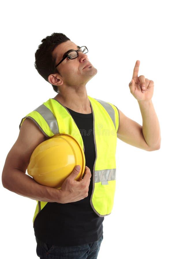 Lookin dell'operaio della costruzione di edifici in su che indica fotografie stock libere da diritti