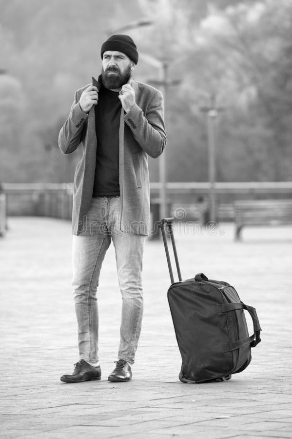 Looking for accommodation. Man bearded hipster travel with big luggage bag wait for taxi bring him to hotel. Travel tips. Traveler with suitcase arrive travel stock photos