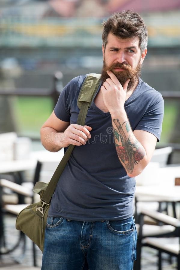 Looking for accommodations. Hipster thoughtful traveler carry travel bag. Business trip. Man bearded traveler hipster. Travel with luggage bag. Let travel begin stock images