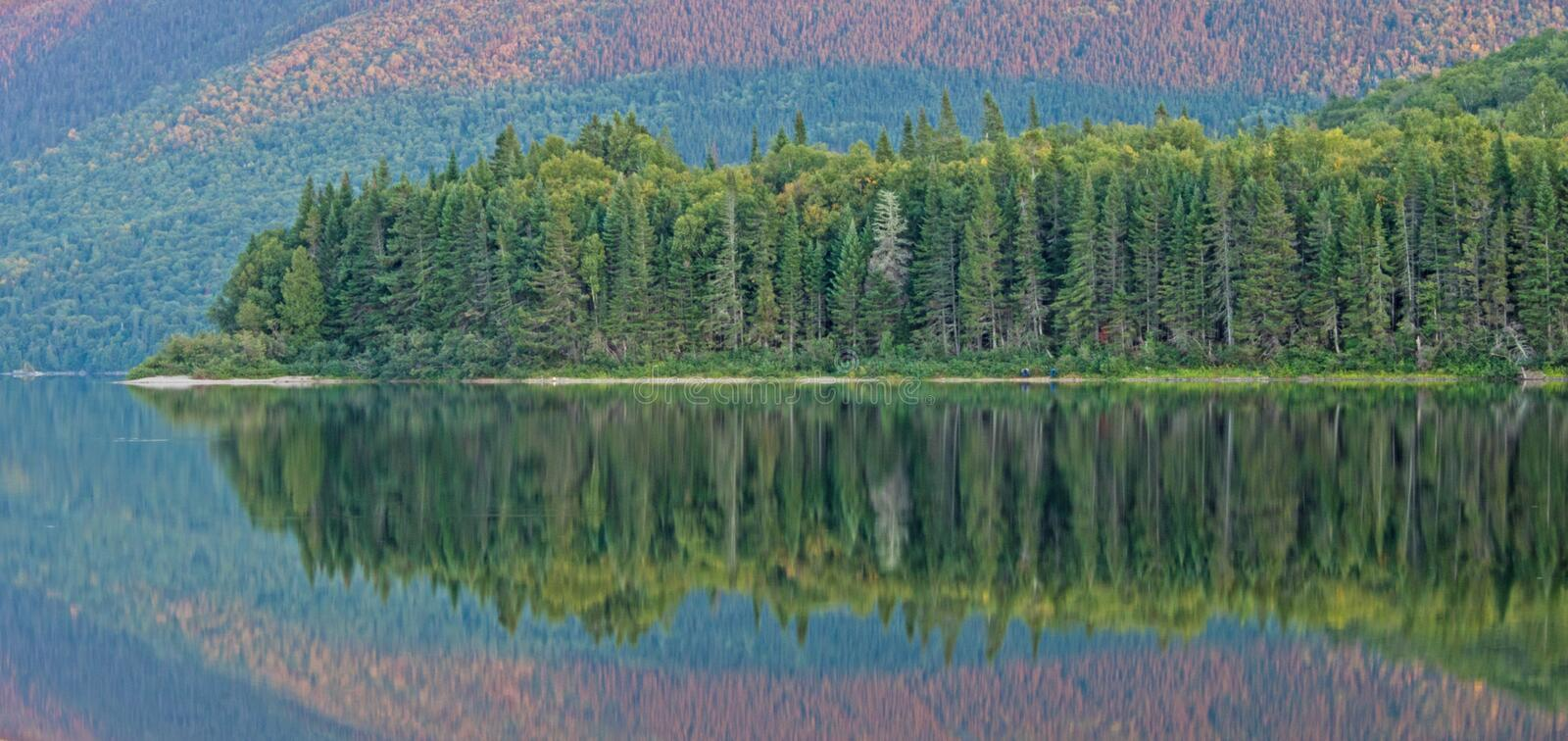 Late Day Reflections On Big Nictau Lake. Looking across Big Nictau Lake at Mount Sagamook in Mount Carleton Provincial Park. The location is in the wilderness of royalty free stock photo