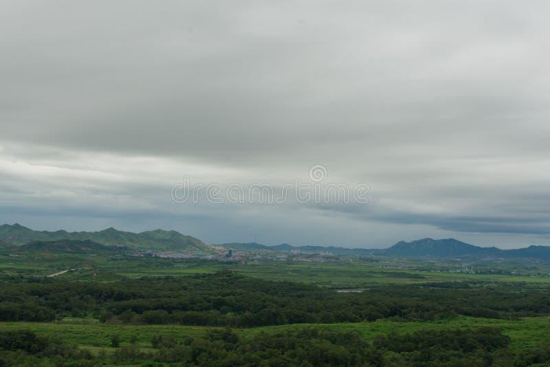 Across the Korean border. Looking across the border into North Korea at the propaganda village stock photos