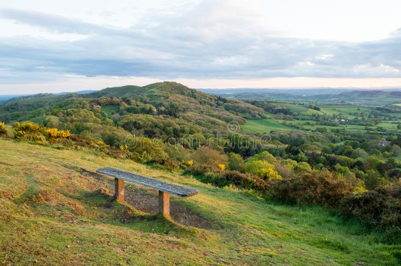 Looking across the hills of the English landscape on a sunny afternoon. The Iron Age hillfort of British Camp, Malvern Hills, UK.  royalty free stock photos