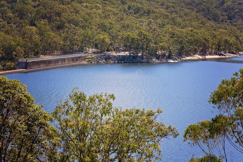 Looking across a vast blue lake. Lake Tinaroo In Australia provides water for the surrounding population royalty free stock image