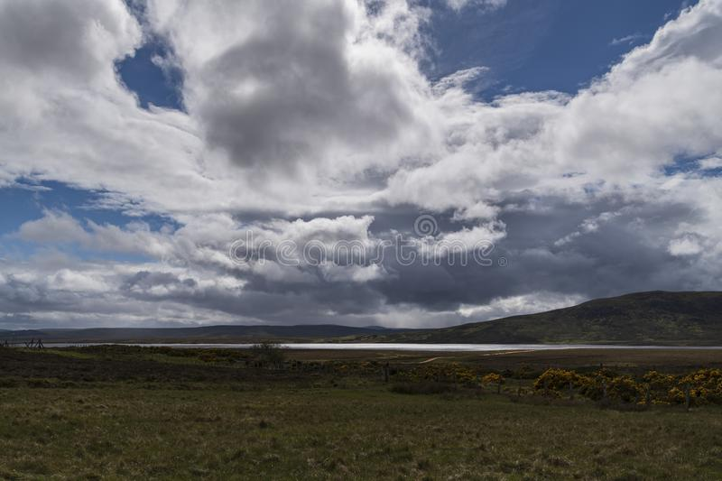 Loch an Rauthair. Looking across the wide open expanse and Loch an Rauthair that make up part the flow country of Sutherland, Scotland royalty free stock photos
