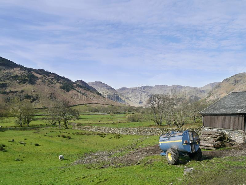 Looking along Great Langdale, Lake District. Looking along fields down the Great Langdale valley with bowser and barn to the right stock images