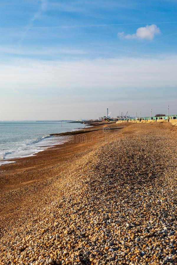 The Pebble Beach at Hove in Sussex. Looking along the pebble beach at Hove, towards Shoreham in the west stock photos