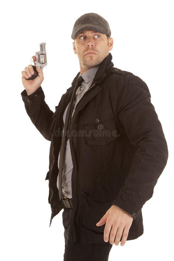 Looking around pistol stock images