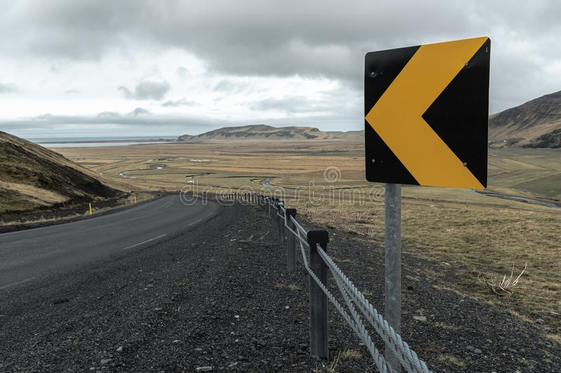 Looking around a sharp corner on highway 1 near Vik, Iceland stock photography