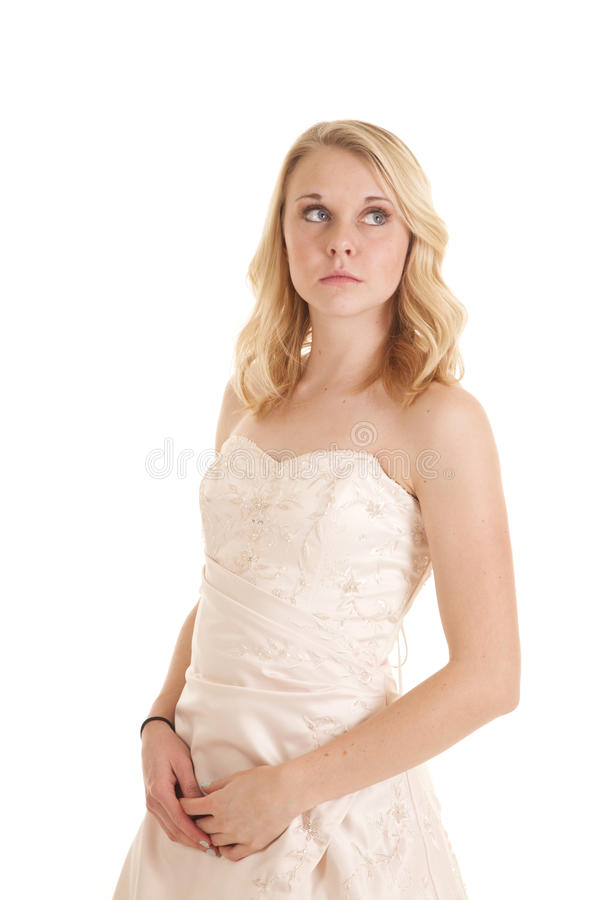 Looking away fancy dress. A woman in her formal gown with a serious expression on her face royalty free stock image
