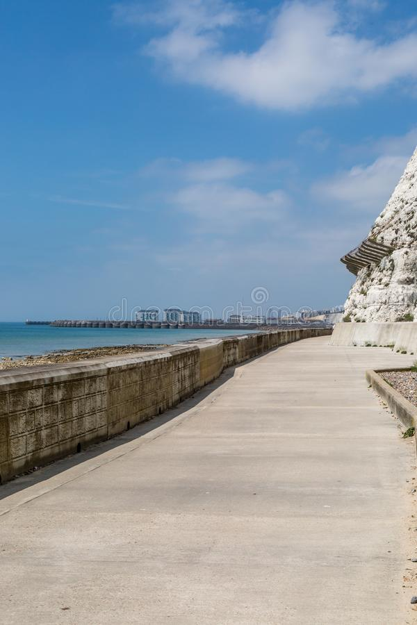 Brighton`s Undercliff Path. Looking back along the undercliff path in Brighton towards the marina stock images