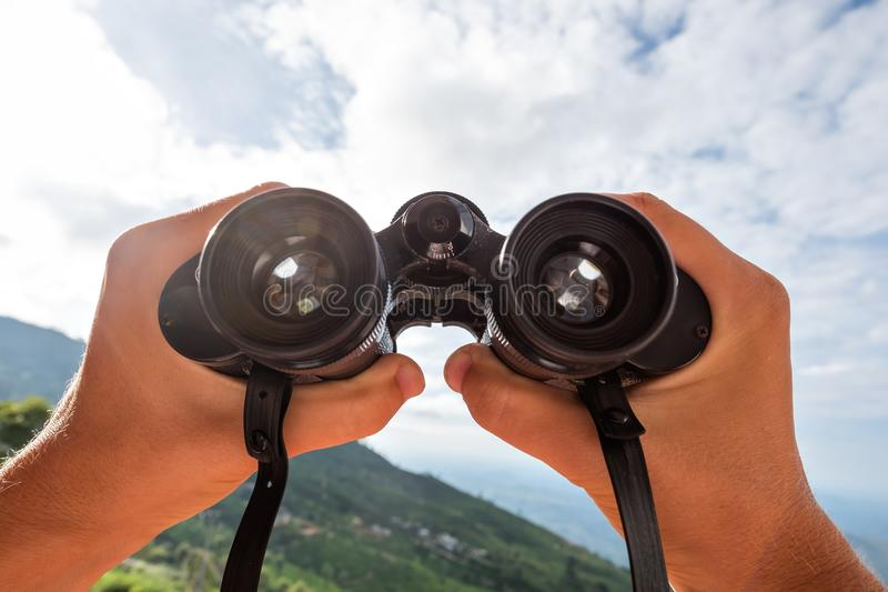 Looking through the binoculars. stock photography