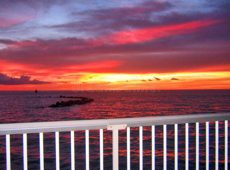 Looking at the blazing sea sunset from the Nightcliff jetty. Darwin, NT Australia. This sunset is magical. Looking from the Nightcliff jetty, Darwin, NT royalty free stock photos