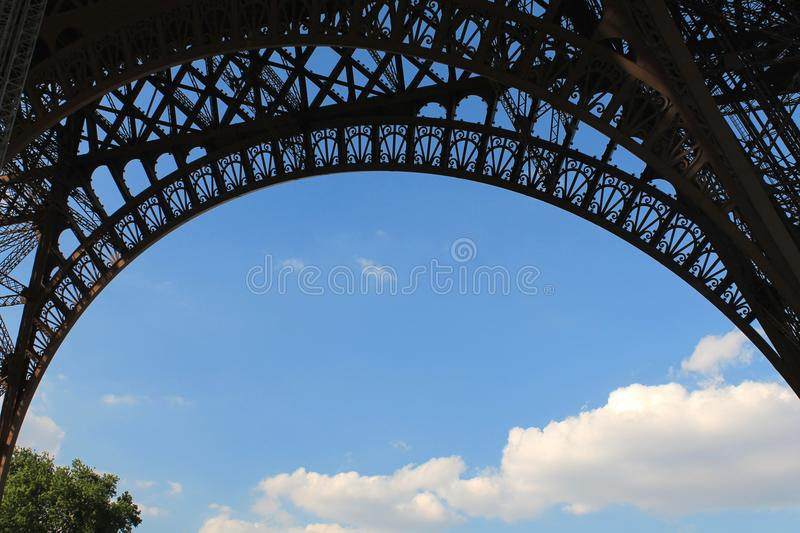 Looking at blue sky and clouds from beneath the Eiffel Tower stock photos