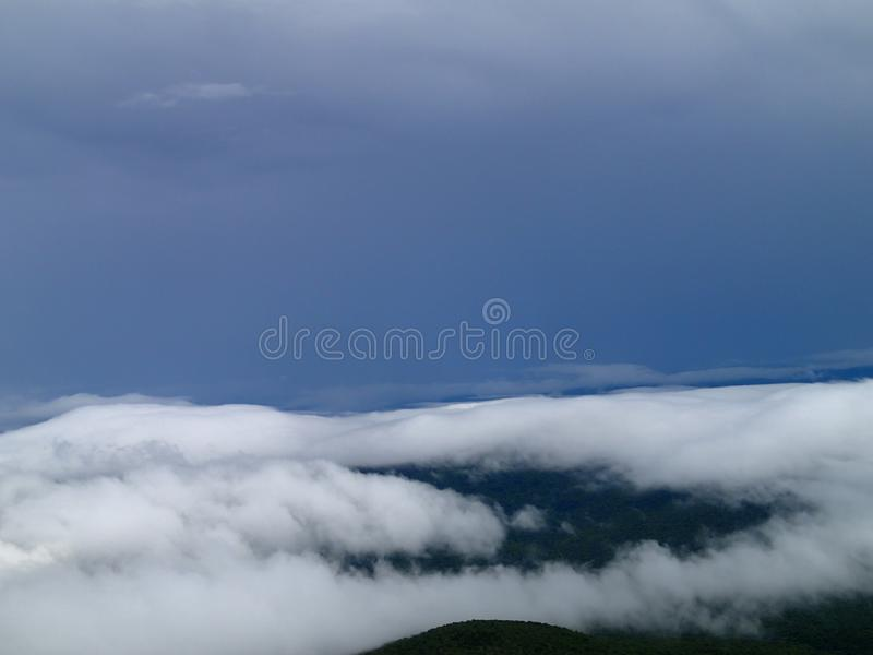 Looking at the breathtaking sight at top of the mountain royalty free stock photos