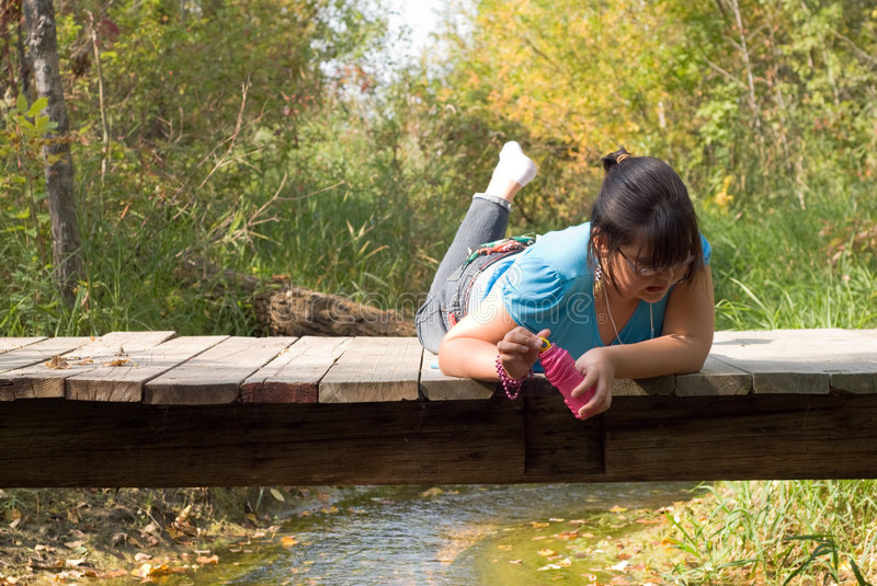 Looking For Bugs. A girl making a gross face while looking for bugs royalty free stock photo