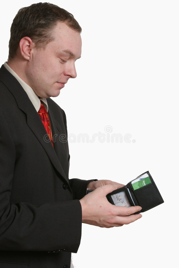 Looking for Cash. A business man opening his wallet stock photography