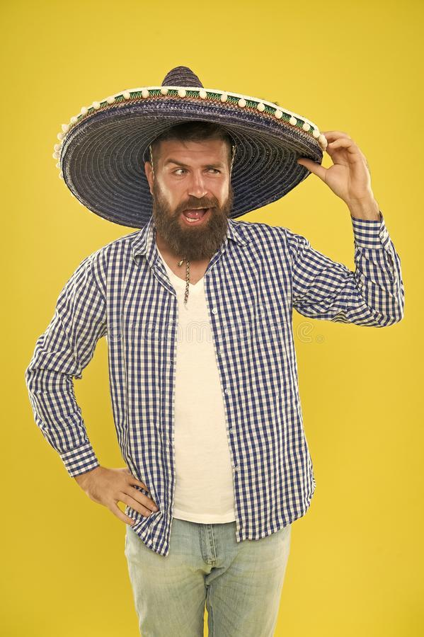Looking cool. He is in love with mexican style. Hipster in wide brim hat. Mexican man wearing sombrero. Bearded man in stock images
