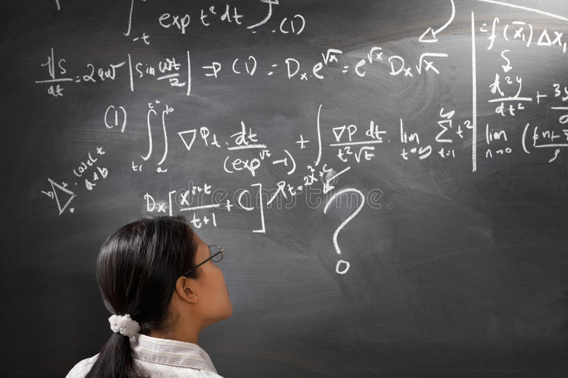 Looking at difficult complex equation royalty free stock photo
